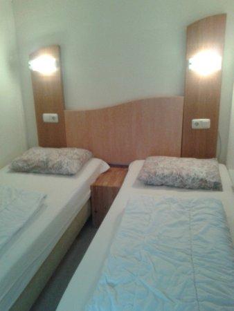 Hollum, เนเธอร์แลนด์: slaapkamer appartement de Vuurtorenwachter