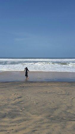 Maia at Varkala Beach, off season July 2015 Clean. Black Sand. High Tide. No Swimming.