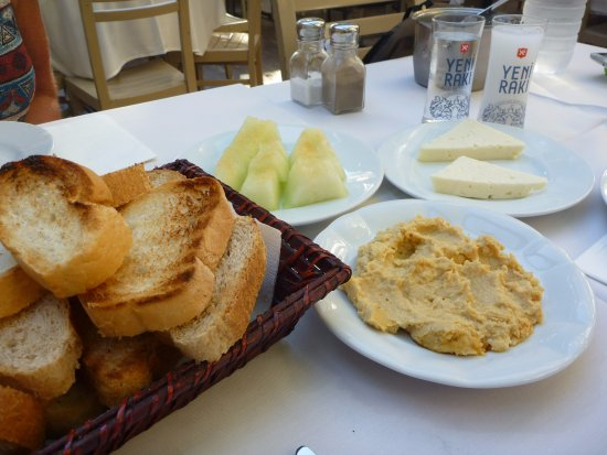 Istanbul Urban Adventures: At a Meyhane having meze (appetiser): hummus, cheese and cantaloupe (melon) washed down with Rak
