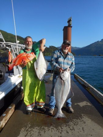 Port Alice, Canada: Craig's Halibut, and John is holding the halibut I brought in.
