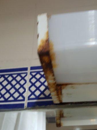 Estalagem do Forte Muchaxo: lampada arruginita
