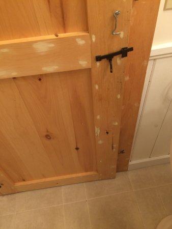 Belfast, ME: unfinished wooden door