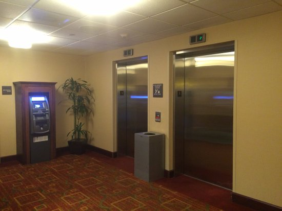 Hampton Inn and Suites Charlottesville - At The University: Otis elevators and atm in elevator bank lobby