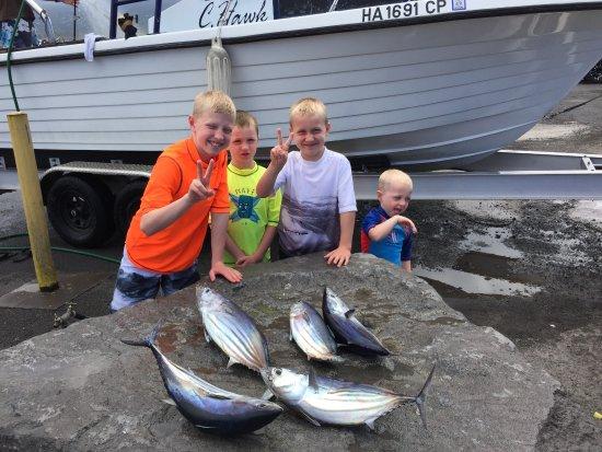 C. Hawk Sea Service: Boys showing their catch