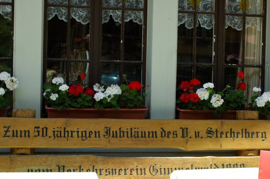 Stechelberg, Schweiz: Front patio bench - watch the world go by from right HERE!