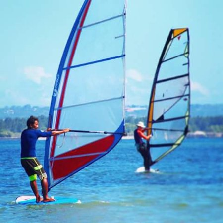 Rip Curl School Of Surf : Windsurfing is a surface water sport that combines elements of surfing and sailing. RCSOS sanur