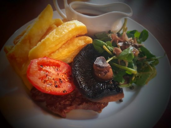 Clevedon, UK: 35 day aged 8oz Ribeye steak, roasted tomato, watercress, shallot & caper salad, triple cooked c