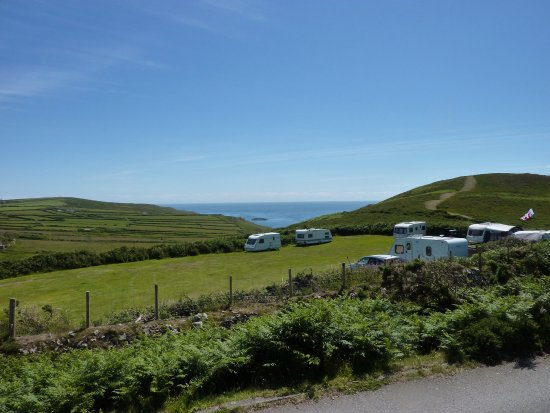 Aberdaron, UK: Sea view from the campsite. 2nd is view from the hill Mynydd Mawr looking down on campsite and t