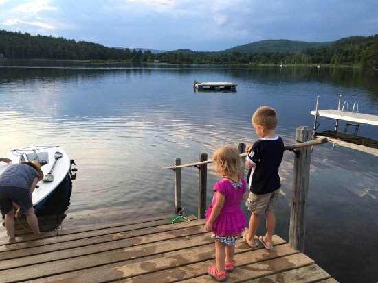 Kids looking out onto Post Pond in Lyme, NH