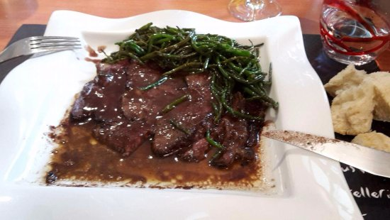 Auvergne, France: Nicely cooked beef with very rich sauce and pan fried crispy sea vegetable(taste of sea!)