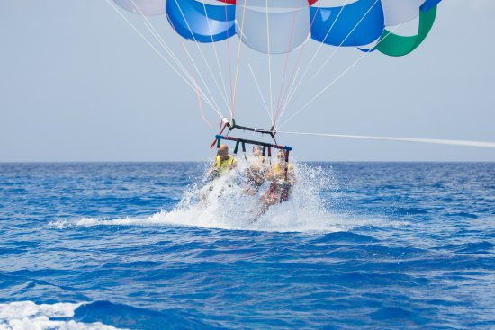 Parasailing Professionals: Parasailing--being dipped in the ocean.