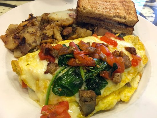 Severna Park, MD: Create your own pan omelette: tomatoes, spinach, cheddar cheese, sausage + home fries & toast
