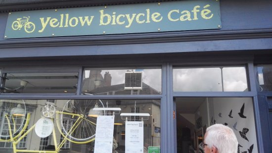 Blandford Forum, UK: Yellow Bicycle Cafe with the proprietors yellow bicycle nailed to the window.