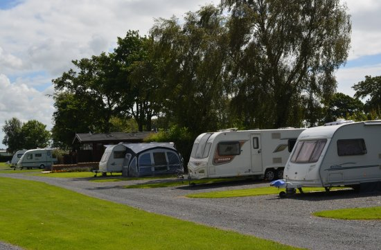 Cockerham, UK: Touring Caravans Pitched by Toilet Block