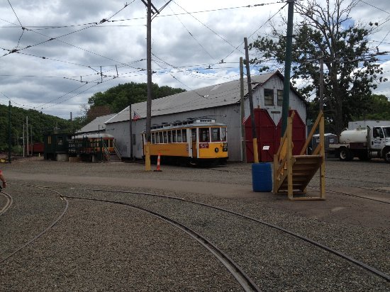 East Haven, CT: One of the Trolleys next to a Trolley Barn