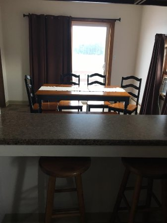 Machias, ME: Dining room and private balcony in our 2 bedroom apartment