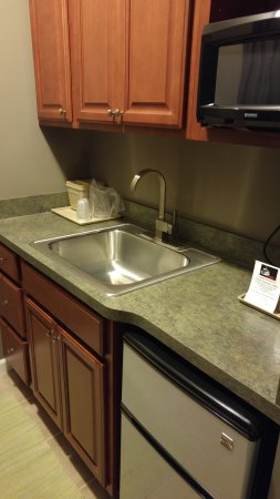 Dushore, PA: Kitchen area in room with basic eating utensils, dishes, cleaning supplies