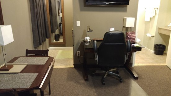 Dushore, PA: Bedroom with recliner, eating table, desk and large-screen TV.