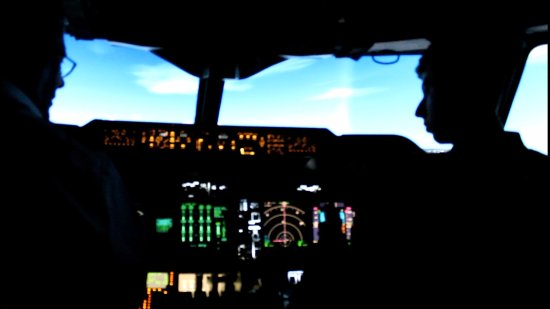 Coventry, UK: Myself (right) with Captain Chris Rigby (left) in the 747-400 simulator.