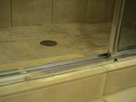 Wyndham Governor's Green: The lower shower stall rail showing the drain holes facing the wrong direction