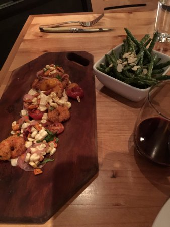 Tinderbox Kitchen: Spicy shrimp with corn relish, side of blistered green beans.