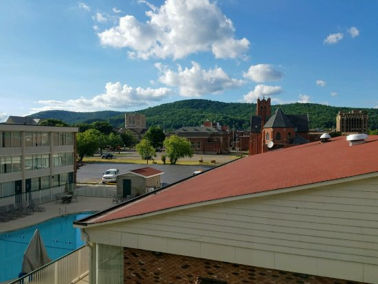 Bradford, PA: View of pool, St Bernard church, United Methodist church, and hills