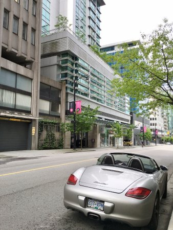 Coast Coal Harbour Hotel: View of the hotel entrance with the pink banner across the street.