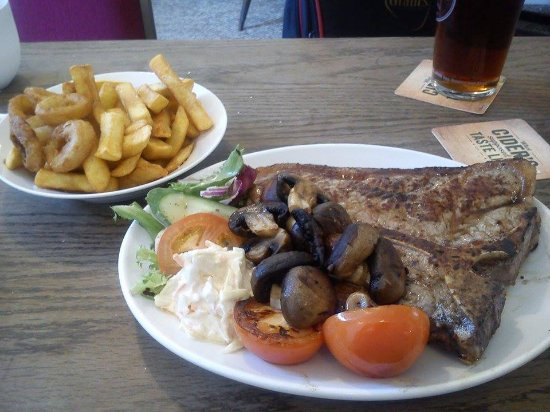 St Dennis, UK: Special T-bone meal cooked for me on Thursday 14th July 2016, a few chips left over, but a great