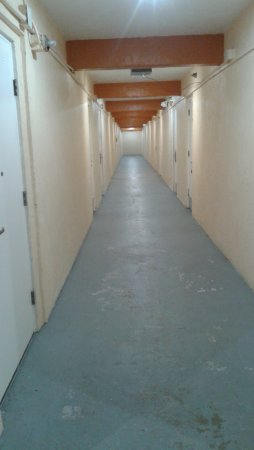 Super 8 Daytona Beach Oceanfront: This is the hallway you go down for the room, looks like a storage facility