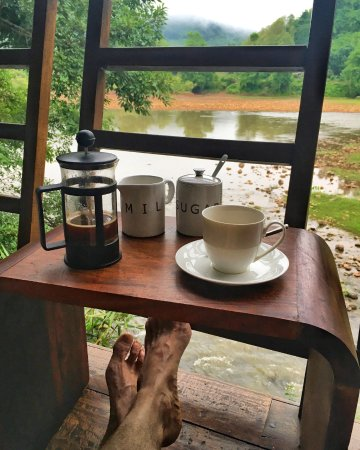 Muang La, Laos: Sitting on our veranda overlooking the Nam Pak river with delicious French Press Lao Coffee.