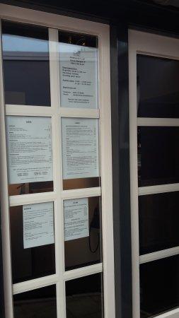 Elst, Nederland: menu and other information on the entrance door
