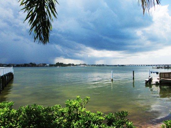 تريدويندس بيتش ريزورت: Rain in the distance and we are heading inside...Here in Florida, when thunder roars, go indoors