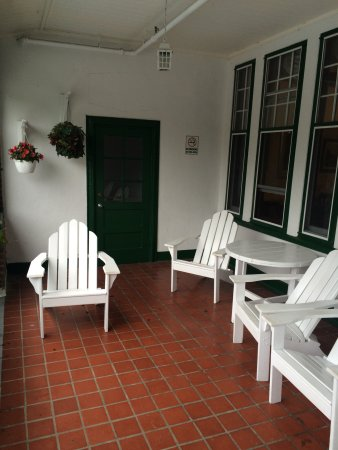 Glynmill Inn: We watched the rain from these chairs on the protected balcony.