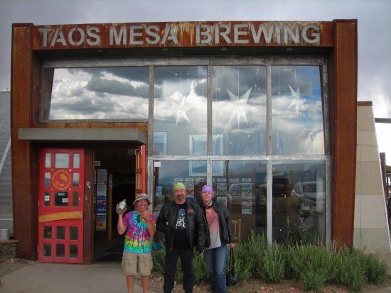 Taos Mesa Brewing: This guy on the left was happy to be in our pic notice the clouds in the reflection