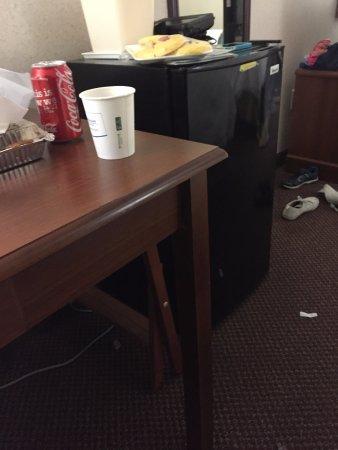 Dowagiac, MI: nightstand held up by fridge