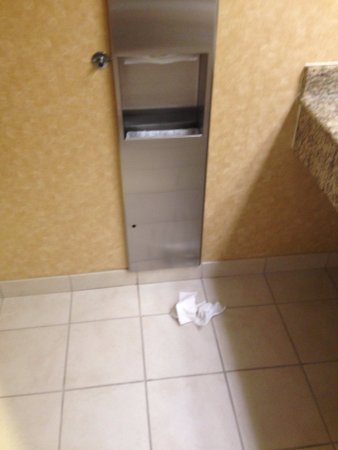 Jeffersontown, Кентукки: Lobby floor men's restroom - trash on floor