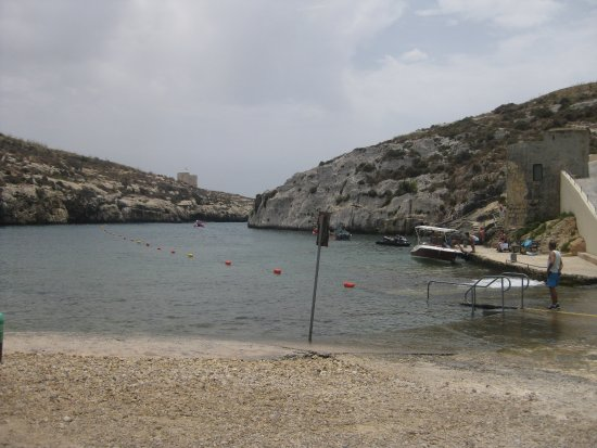 Xewkija, Malta: About half the bay roped off for boats