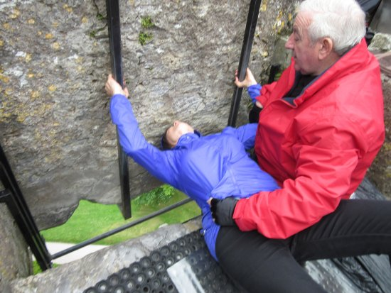 Greystones, Ireland: Puckering up for the Blarney Stone. Corny, I know, but had to do it!!