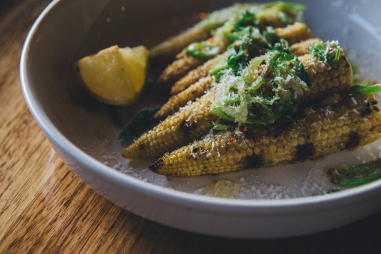 Thornbury, Australia: Baby corn marinated in coconut milk, then grilled and served with garlic butter, spring onion an