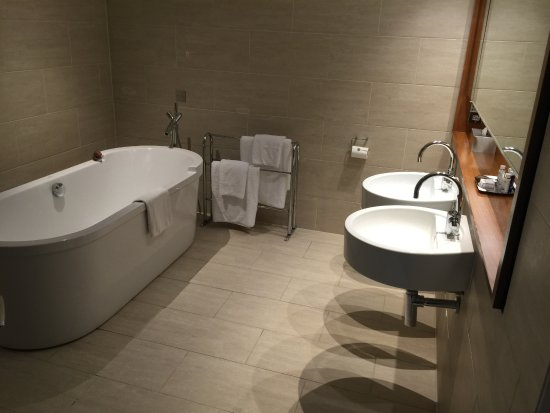 Huge Bathroom Walk In Shower Behind Wall Of Bath Picture Of Apex