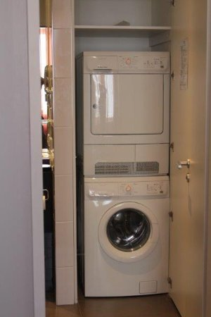 Washer/Dryer unit within apartment. - Picture of Adina ...