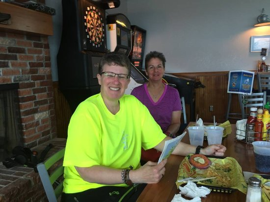 La Pointe, WI: My sister and sister in law enjoy a joke while having their meals.