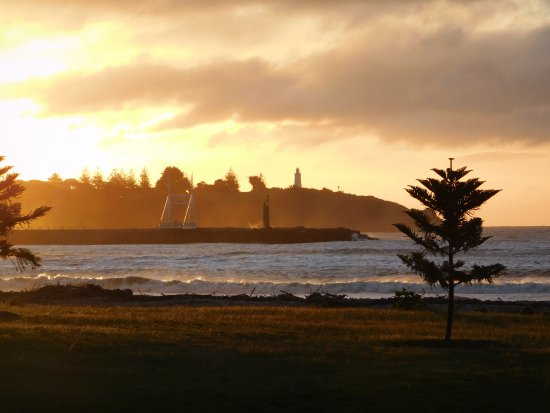 iew from the nearby beach across Devonport Harbour sunset same day