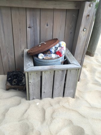 Ocean Side Court: Overflowing trash can. Also the sand getting out of control.