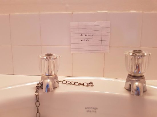 "Highland House Hotel: Why have a sink in the room there is ""no running water""."
