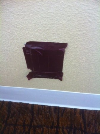 Crowne Plaza Hotel Madison: A unique way to fix an electric socket.
