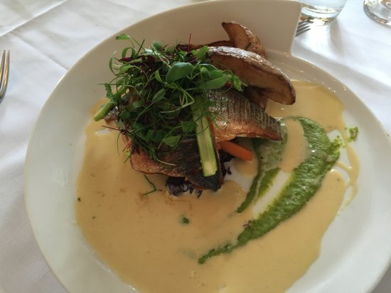Plympton, UK: Sea Bass with double-fried homestyle fries - the sauce was super tasty!