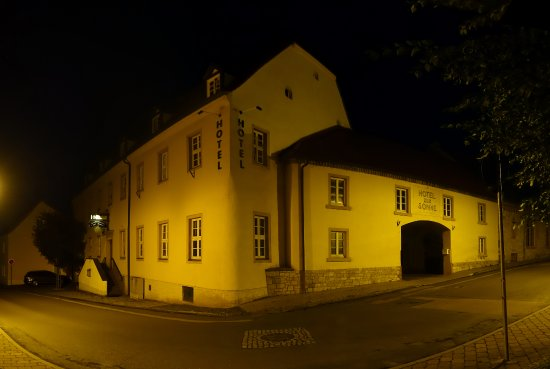 Querfurt, Deutschland: View from street. The entrance to the car park is through the gate at the right,