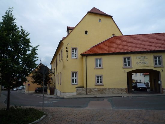 Querfurt, Deutschland: View from street. The car park is visible through the gate.