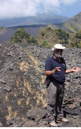 Legendary Sicily: Eddy explaining about the lava flow, with Mount Etna and the broom in the background